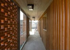 Perforated brick screen/concrete floor/timber walls and ceilig