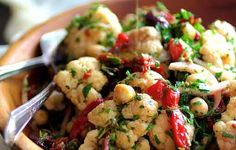 Warm Roasted Cauliflower and Chickpea Salad  http://www.prevention.com/eatclean/warm-salad-recipes/slide/5