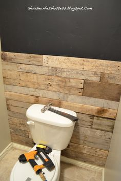 Downstairs Bathroom Accent Wall- done here in pallett wood. You could even do faux brick.