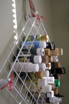 Perfect. She used two shelves from one of those wire shelving units and zip tied empty thread spools in all four corners and the middle.