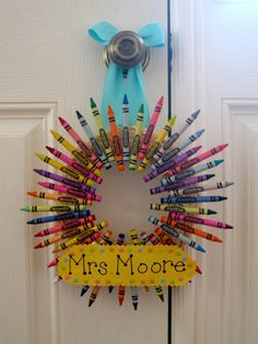 PERFECT gift for a teacher! Any teacher would love to have this colorful wreath in their classroom! This wreath is 1 foot across (to outer tips of crayon). In order please include:    *Whether you want a name tag on wreath  *The name you want on the name tag  *The color of paper for name tag