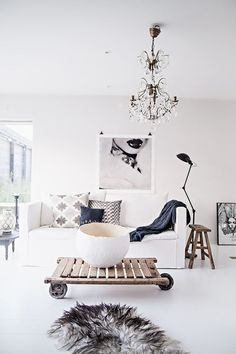 Modern and eclectic all white living room