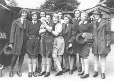 A party of Land Girls wear their best uniform on a visit to Maidstone Zoo in 1943.  The day out was organized by the local officer for girls working in the area.
