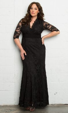 Effortless beauty meets classic style with our Screen Siren Lace Gown. Designed with all-over stretch, this elegant fit and flare evening dress will flatter and accentuate your beautiful curves. A ruched waistband in a contrasting fabric pulls the eye inward to the smallest part of your body and a scalloped neckline and sleeves add that special detailing. The ideal formal pick for any black tie affair. Available exclusively in women's plus sizes.  Made in the USA   Self: 75% Stretch Nylon...