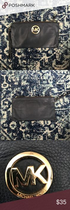 Michael Kors  Navy Wristlet Michael Kors Navy Wristlet, oversized can fit multiple items- phone , wallet , keys , etc. some scratches on the gold MK detail ( shown in pics ). Michael Kors Bags Clutches & Wristlets