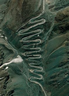"""""""Los Caracoles Pass, or The Snails Pass, is a twisting mountain road located in a remote section of the Andes Mountains on the Chilean side of the border with Argentina. The path climbs to an elevation of 10,419 feet, has no roadside safety barriers, and is frequented by large trucks."""""""