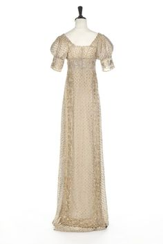 A silver-strip embroidered muslin dress, circa 1805-10. elaborately worked…
