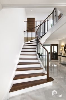 An elegant sweep and a #twotonefinish with steel spindles create an instant #futureclassic. Need inspiration for a new staircase? Visit our website and take a look at our projects!
