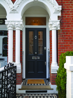 Four-panel door: authentic heavy mouldings, painted dark grey, complements the tiled path. It has been made from solid accoya wood, which is treated to be extremely durable and stable, and is finished with smart polished chrome door furniture. Front Door Steps, House Front Door, Dark Grey Front Door, External Hardwood Doors, Traditional Front Doors, Victorian Front Doors, Edwardian House, Victorian Terrace, Victorian Houses