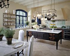 french country inspired kitchen with green tile blacksplash. I love the expanse and comfort of this look!