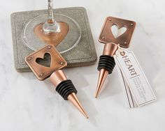 It looks great on the table, but it looks even better inside your favorite bottle of wine! This Copper Heart Bottle Stopper, from the Copper and Concrete collection, is a useful but unique wedding fav
