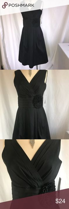 Julian Taylor black evening dress Still looking for that little black dress. Here is ones! Has a flower appliqué that can be removed. Tulle underneath to give it a full look Julian Taylor Dresses