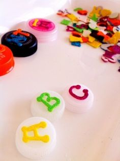 stamps made from foam letters and bottle caps