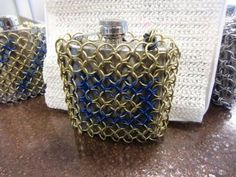 Protect your drinks!   Chain mail covered flask.  Nice!   Bcchains Chain Mail and more on facebook. Chain Mail, Flask, Facebook, Drinks, Nice, Drinking, Beverages, Chain Letter, Drink
