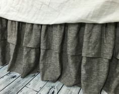 You will love this stone grey ticking striped bed skirt, custom made in natural linen, sturdy. 2X gathered ruffle made with natural linen, decking is made with strong durable white cotton fabric.  Now you have the option of replacing traditional decking with the valcro strips for easy install and laundry, see here: https://www.etsy.com/listing/270617583/easy-on-bedskirt-with-valcro-detachable  If you want lined bed skirt, add the option here:  https://www.et...