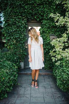- Stripe dress with side pockets. - Side zipper. - Stripes are blue. - Lined…