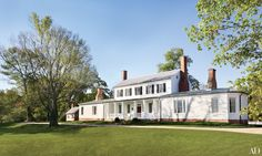 Dating from the 18th century, Rose Hill in Virginia's Rappahannock Valley was restored by Tidewater Preservation and decorated by Amelia T. Handegan, with garden design by Rieley & Assoc. Landscape Architects. The exterior is painted in a Sherwin-Williams white.