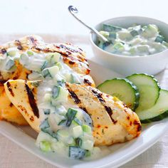 Dress up basic grilled chicken with refreshing mint and cucumber sauce. Recipe: http://www.bhg.com/recipe/chicken/grilled-chicken-with-cucumber-yogurt-sauce/?socsrc=bhgpin060112