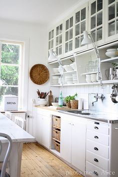 wall mounted faucet makes it easy to keep clean around the fixtures.  also, open shelves/baskets for storing squash, potatoes, etc.