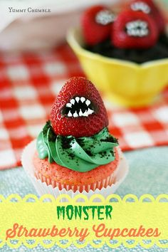 Moist strawberry cupcakes with vanilla buttercream and crushed oreo cookies with a frightening strawberry monster. www.yummycrumble.com