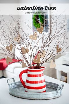 Use branches from your backyard to create the most adorable & simple DIY Valentine tree! Perfect for Valentine decor, and even wedding centerpieces!