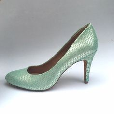 NWOT Vince Camuto pumps NWOT! Absolutely stunning mint green silver heels from Vince Camuto. Gorgeous mermaid scale pattern. Add a poppy fun to any outfit! Never worn outside, only tried on inside! Light blue, green color is on trend. Vince Camuto Shoes Heels