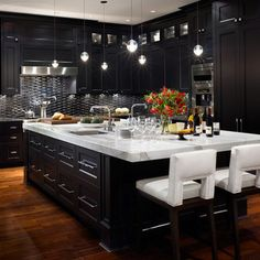 Vancouver 5 - Very Elegant kitchen using a flat panel maple door painted black with a stunning White countertop and bar stools