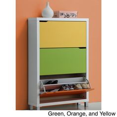 This fun Simms modern shoe cabinet features a white paper veneer frame with a green, yellow, and orange door. When you open a drawer, you will see two divided shelves. You can fit three pairs of shoes in each shelf for a total of six pairs per drawer.