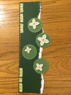 Using the tearing tool, tear your 12 inch paper. Or, to get more of a 'torn' look, just tear it! cut 4 circles with the Shape Maker circle (or any circle!) add a few stickers, dot and stitch with the Silver Creative Memories pen and in 5 minutes you have a border. (Lanita Facebook page).