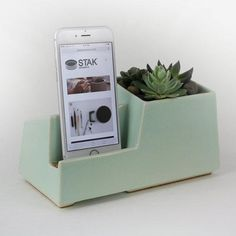 A sleek, handmade phone dock with a sidecar for succulents. #etsyhome