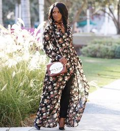 Floral Maxi dress with Black skinny jeans for the fall. l DAILYLOOK Elite - personal styling service delivered right to your door