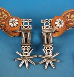 """FIND MORE  @ https://www.etsy.com/shop/cowboy2873?ref=hdr_shop_menu Double-band, full, silver inlaid Mexican spurs with 3"""" inlaid rowels, filigree shanks and rear bands. Fine silver twisted wire on each side. Swinging buttons in flower pattern, straps adorned with piteado thread, c.1930s, mfg in the 1870s Republic of Mexico style"""