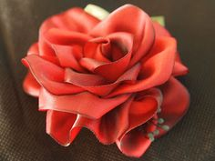 A beautiful rose made from ribbon! #crafts #DIY https://www.retailpackaging.com/categories/74-everyday-specialty-ribbon/products/3019-flora-satin