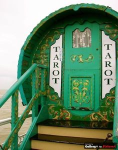 """This green moon door is a perfect entryway for a """"seer"""" like a tarot reader! The unexpected shape and color suggest new possibilities on the other side."""