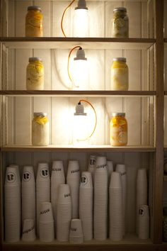 Attendant takeaway cups alongside Mason Jars with lights and preserved lemons