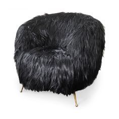 SOUFFLE CHAIR BY KELLY WEARSTLER | Silky Black Goat Fur wraps the rounded silhouette of our classic Souffle Chair for an extraordinarily elegant effect. Each hardwood frame is double-doweled. | http://bocadolobo.com/blog/ #limitededition