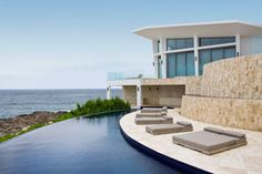 Swimming Pool: Minimalist Home Architecture Picture Gallery Also Outdoor Bed Ideas Also Cute Curved Infinity Pool Design: Outstanding Swimming Pool Designs Close Blue Sea