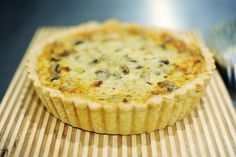Quiche used 1 can evaporated milk and 4 eggs, 1/2 lb bacon,1/2 onion chopped and 1/2 container of mushrooms chopped, large jar quartered artichoke hearts