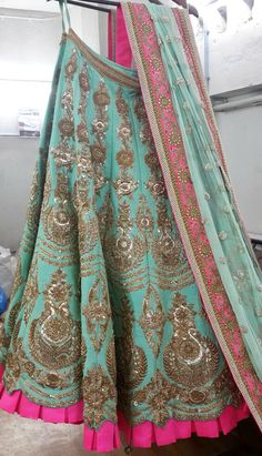 Teal and pink bridal lehenga.
