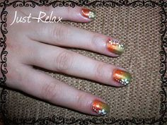 Orange and Green gradiant nails with white flower.