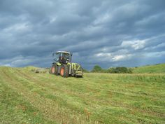 Farmer at work under dramatic sky at Hornton Grounds Farm, Oxfordshire