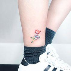 SloppyJoe | Ariel swimming on the ankle. (via IG - tattooist_ida) #Disney #DisneyTattoos #Ariel #LittleMermaid | Tattoodo