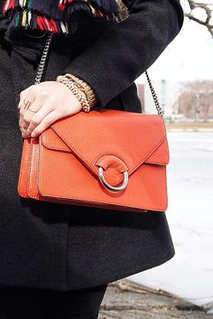 Sveta Damiani Adds A Pop Of Color To Her Look With Our Red Italian Leather Accordion Bag The Perfect Statement Accessory For Spring Banana Republic