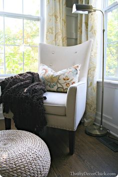comfy chair for by the fireplace with a floor poof!  That's my spot!