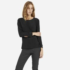A silk long sleeve that's easy to dress up or down 100% silk Fabric is a washed crepe-de-chine that shows a subtle lustre on darker colors Button at cuff Blush color is slightly sheer Dry clean only