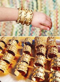 These gold cuff bracelets are made from toilet paper rolls with optional macaroni designs. Cut, paint and add coins or jewels for a Byzantine style cuff.