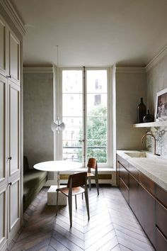 In Joseph Dirand's Paris apartment all details combine to create an overall feeling of elegance and harmony. In the galley kitchen, Dirand used Calcatta verde marble and parquet floors. The tap is by Belgian brand Obumex.