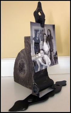 Old hinge and wood = great home decor.  Must make.