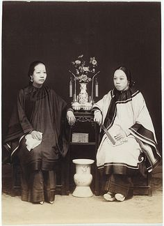 Two Chinese women, one with bound feet c. 1885