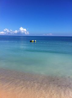 Hilton Rose Hall Resort & Spa All Inclusive - Montego Bay, Jamaica | Who's up for a swim to kick off the week? We'll race ya to the float! View Deals!